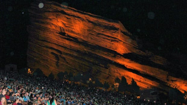 A nighttime photo of one of the rock formations at Red Rocks Amphitheatre in Morrison, Colorado.
