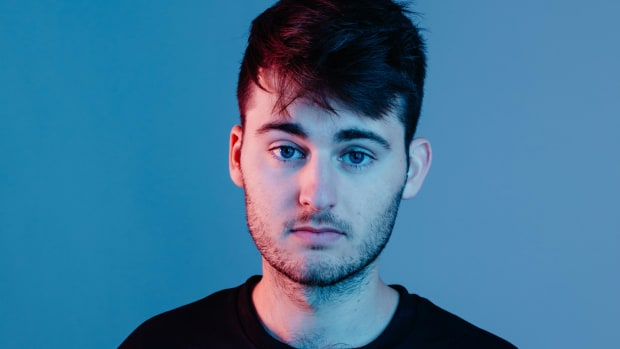 Press photo of Australian DJ/producer Throttle over a blue background.