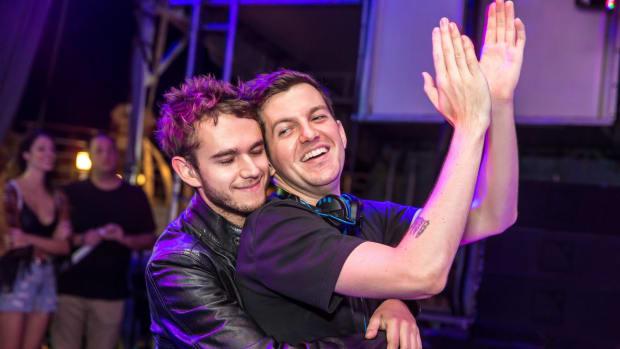Zedd hugging Dillon Francis from behind at Holy Ship!
