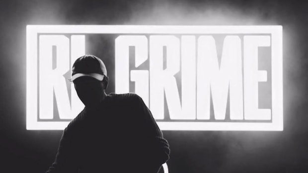 Black-and-white photo of bass music DJ/producer RL Grime during performance.