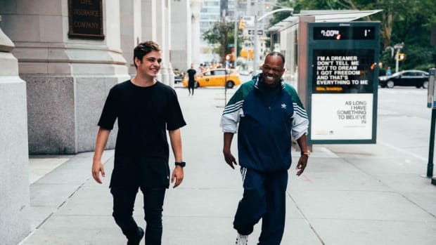 A photo of Dutch superstar DJ/producer Martin Garrix walking with America's Got Talent star Mike Yung.