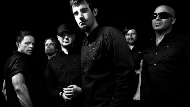 "A black-and-white press photo of Australian drum and bass group Pendulum (comprised of Gareth McGrillen, Rob SwireGareth, McGrillenPaul ""El Hornet"" Harding, Peredur ap Gwynedd, and KJ Sawka)."