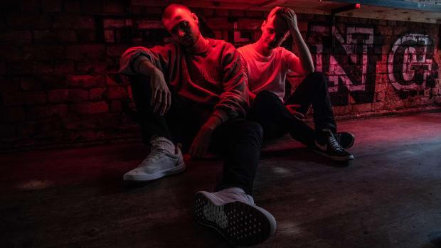 Duke & Jones Press Photo - Dark with Red Light against Stone Wall