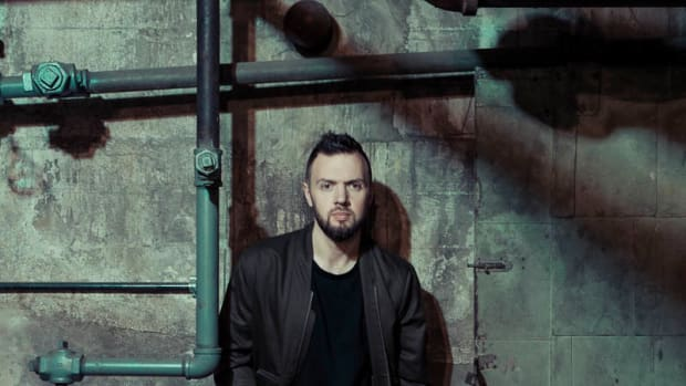 Chris Lake Press Photo, Grungy Basement Wall With Pipes