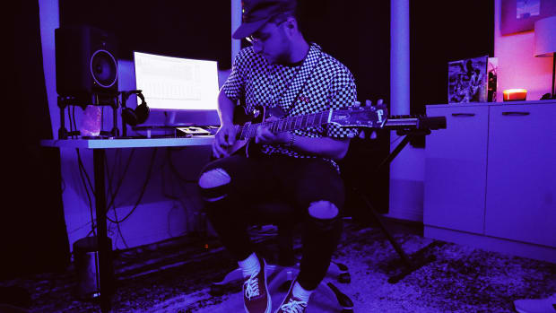 Prince Fox Playing Guitar In Checkered Shirt With Purple Lighting