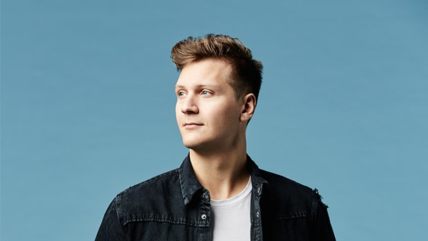 A color photo of DJ/producer Matoma with a blue background.