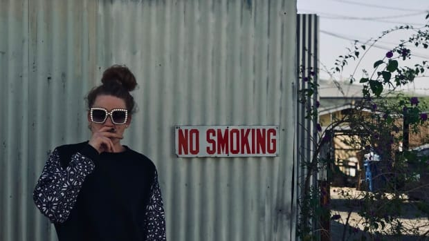 Ethan Glass Smoking Infront of No Smoking Sign