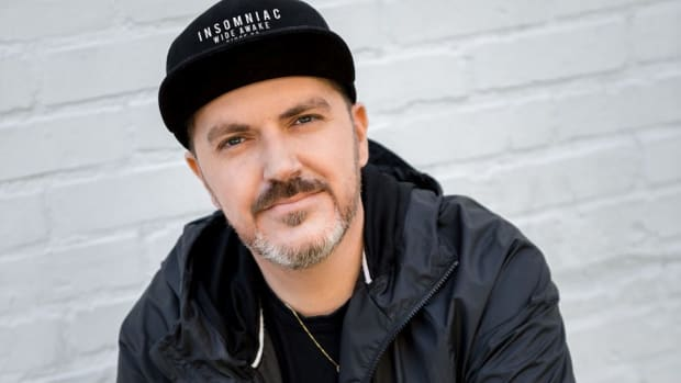 A color head shot of Insomniac Events founder Pasquale Rotella wearing a black hat and jacket.