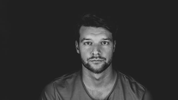 A black-and-white head shot of Finnish DJ/producer Yotto (real name Otto Yliperttula).