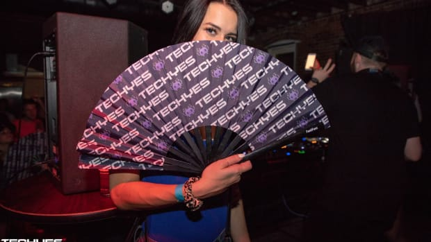 TechYes Fan Holding a Fan