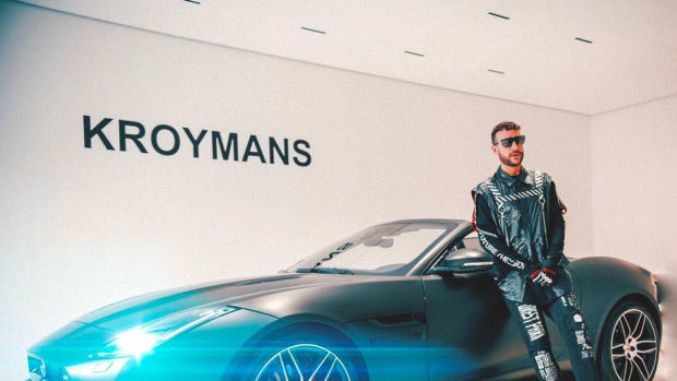 Don Diablo standing with his new Jaguar at Kroymans.