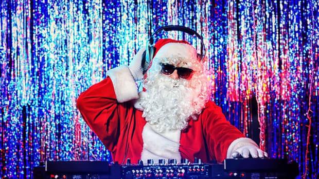 bigstock-DJ-Santa-Claus-mixing-up-some-39865849-800x465