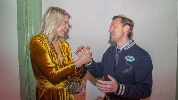 Ada Hegerberg and Martin Solveig shaking hands at the Ballon d'Or Award Ceremony in Paris, France.