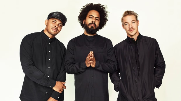 A press photo of Diplo's Major Lazer project with J Balvin in the photo.