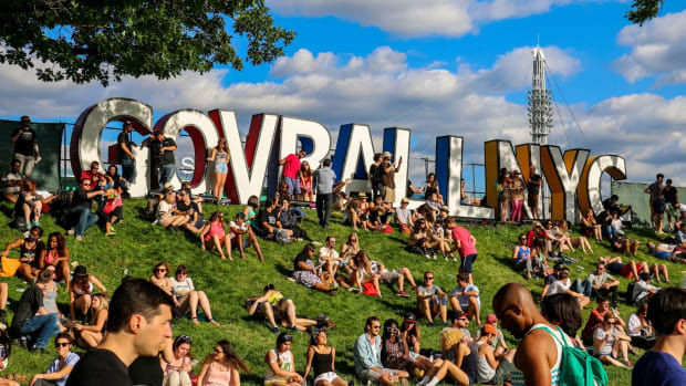 A photo of people sitting on a grassy hill at Governors Ball Music Festival in New York City (NYC).