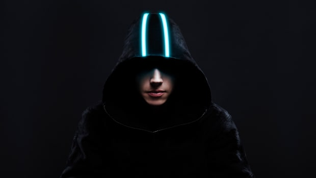 Liquid Stranger wearing a glowing hood.