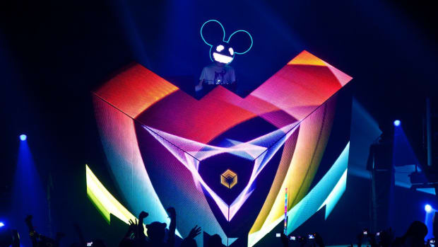 A photo of Canadian DJ/producer deadmau5 A.K.A. Joel Zimmerman performing on his Cube stage concept.