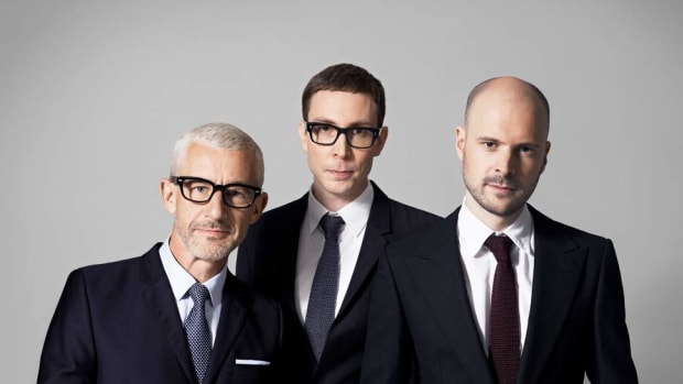 A photo of Above & Beyond (consisting of Jono Grant, Tony McGuinness, and Paavo Siljamäki) wearing suits.