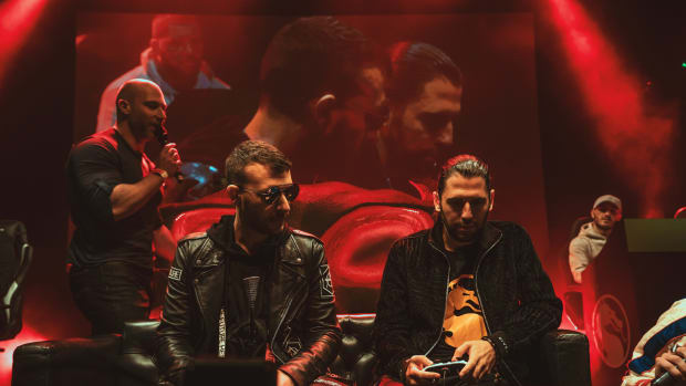 A photo of Belgian superstar DJ/producer duo Dimitri Vegas & Like Mike playing Mortal Kombat.