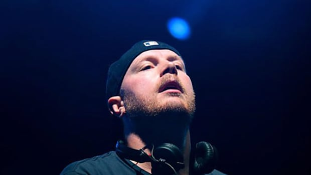 A photo of Swedish DJ/producer Eric Prydz facing upward during a performance.