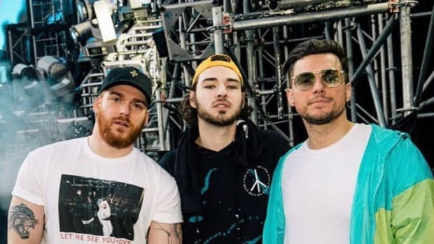 A photo of Christian Srigley and Leighton James of Adventure Club standing with Christian Smith.