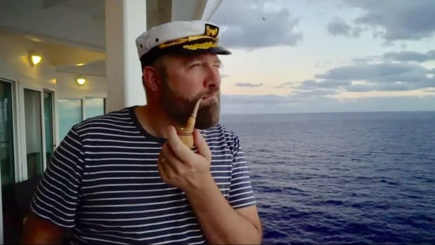 San Francisco DJ/producer Claude VonStroke smoking a corncob pipe at cruise ship festival Holy Ship!.