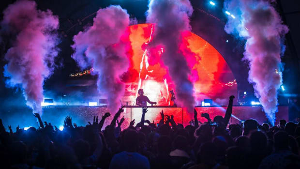 A photo of CO2 cannons going off during a DJ set at Electric Zoo festival.