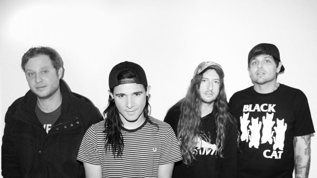 A black-and-white photo of post-hardcore band From First To Last, whose frontman is Skrillex (real name Sonny Moore).