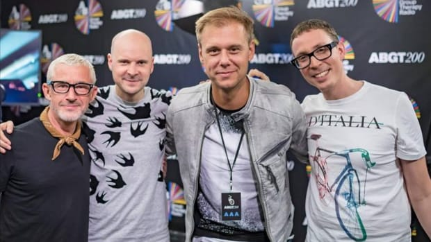 A photo of English trance trio Above & Beyond with Dutch DJ/producer Armin van Buuren.