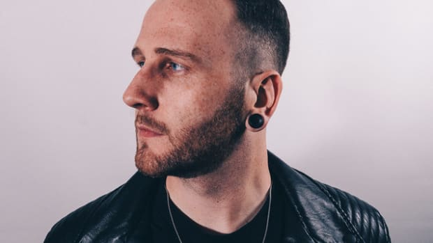 A profile angle photo of English DJ/producer Zomboy (real name Joshua Mellody).