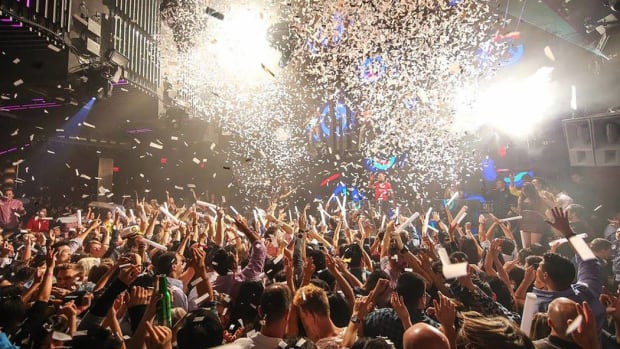 A photo of a crowd with confetti coming down at MARQUEE nightclub.
