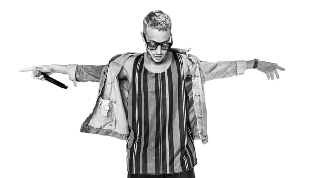 A black-and-white photo of DJ Snake (real name William Sami Étienne Grigahcine) over a white background.