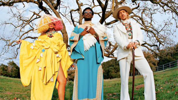 A press photo of LSD members Labrinth, Sia and Diplo wearing flamboyant outfits.