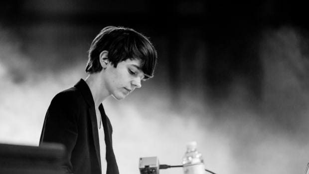 A black-and-white photo of DJ/producer Madeon (real name Hugo Pierre Leclercq) during a performance courtesy of Rukes.
