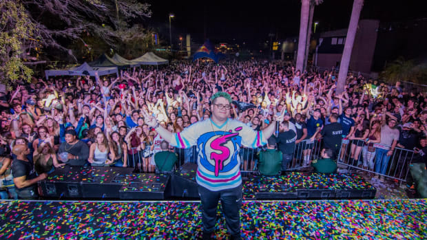 Los Angeles DJ/producer Slushii (real name Julian Scanlan) standing in front of a crowd.