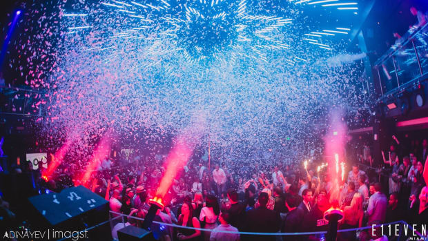 Miami nightclub E11EVEN with confetti cannons shooting over a crowd.