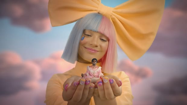"A giant Sia holding Labrinth in the video for LSD's ""No New Friends"" from the album Labrinth, Sia and Diplo Present... LSD."