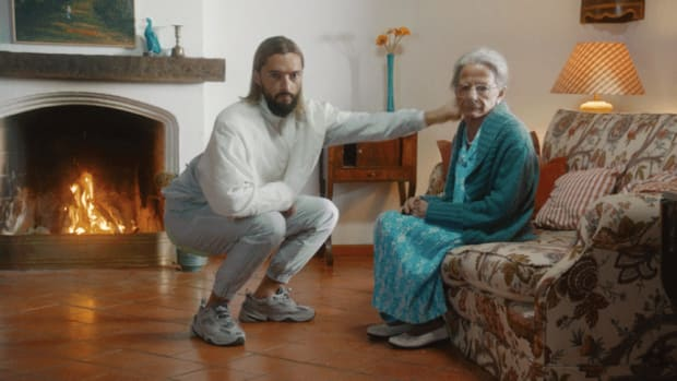 "A still image of Bosnian DJ/producer Salvatore Ganacci punching an old woman from the music video for his 2019 single ""Horse."""