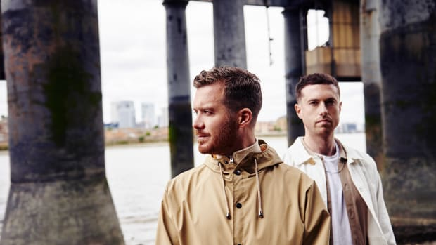 Color photo of Gorgon City standing in a dilapidated building.