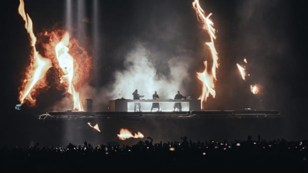 EDM supergroup Swedish House Mafia (comprised of Sebastian Ingrosso, Steve Angello and Axwell) surrounded by pyrotechnic flames during a 2019 performance at Tele2 Arena in Stockholm.