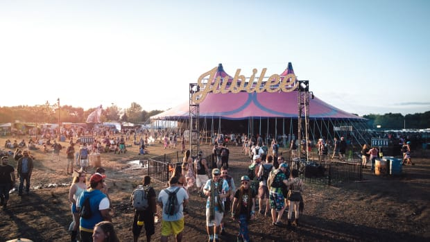 electric forest jubilee tent at sunset