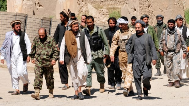 Taliban_insurgents_turn_themselves_in_to_Afghan_National_Security_Forces_at_a_forward_operating_base_in_Puza-i-Eshan_-a
