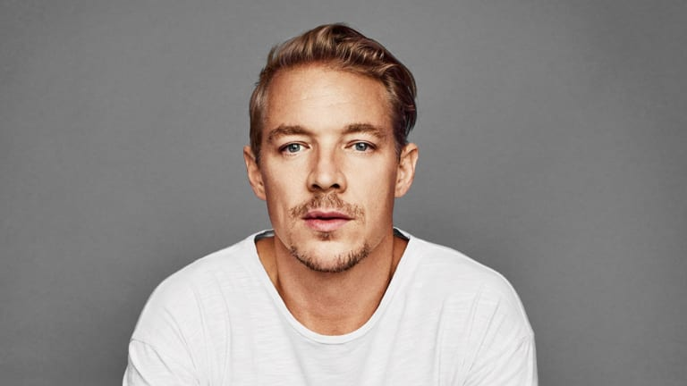 "Diplo Delivers Wholesome Holiday Parody of Travis Scott's ""Sicko Mode"""