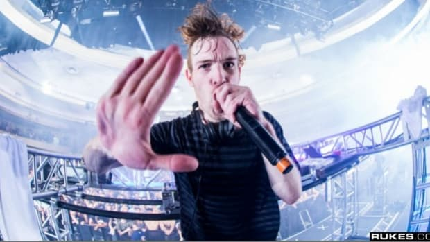 Rusko performs on stage