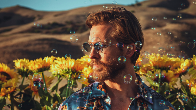 """Watch the Kaleidoscopic Music Video for Calvin Harris and Tom Grennan's """"By Your Side"""""""