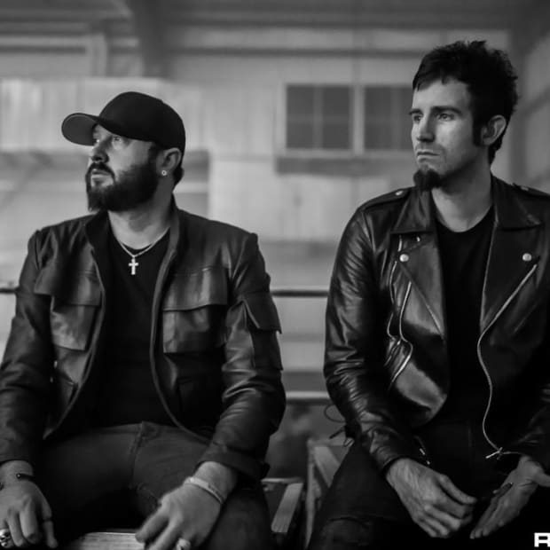 A black-and-white photo of Australian DJ/producer duo Knife Party courtesy of Rukes.