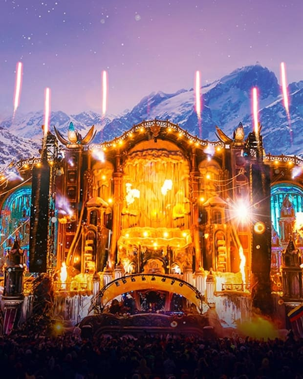 Tomorrowland Winter's 2019 main stage with fireworks or pyrotechnics going off.