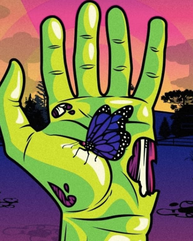 Daybreak Festival zombie hand with butterfly graphic.