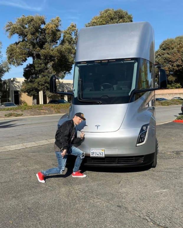 deadmau5 (real name Joel Zimmerman) standing in front of a Tesla Semi truck.