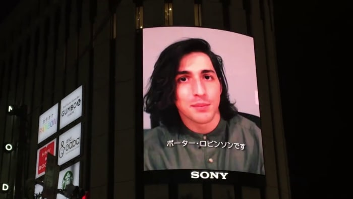 """Screenshot from Robinson's premiere of the """"Shelter"""" music video in Tokyo."""